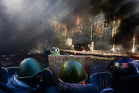 Protesters faces the riot police behind their shields. Kiev, Ukraine