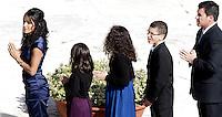 Jake Finkbonner, secondo da destra, con i suoi familiari, attende di ricevere la comunione durante la cerimonia per la canonizzazione di sette nuovi santi, in Piazza San Pietro, Citta' del Vaticano, 21 ottobre 2012. Jake, 12 anni, della tribu' Lummi, fu colpito da fascite necrotizzante al volto all'eta' di 6 anni. Il Vaticano ha dichiarato che la guarigione di Jake e' un miracolo dovuto all'intecessione di Kateri Tekakwitha, nativa americana del 17esimo secolo, proclamata santa durante la cerimonia..Jake Finkbonner, of Ferndale, Washington, second from right, and his relatives wait to receive the communion by Pope Benedict XVI, not pictured, during the ceremony for the canonization of seven new saints, in St. Peter's square at the Vatican, 21 October 2012. Jake, a 12-years Lummi, was infected with a flesh-eating bacteria in 2006. The Vatican determined that Jake's recovery was a miracle due to the intercession of Kateri Tekakwitha, a 17th century Native American who is among seven people who were declared saints..UPDATE IMAGES PRESS/Riccardo De Luca.NO USA SALES