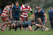Kieran Whyte has to dive backwards to secure the loose ball during the Counties Manukau Premier Club Rugby game between Karaka and Onewhero, played at Karaka on Saturday June 25th 2016. Karaka won the game 15 - 10 after leading 10 - 3 at halftime.<br />  Photo by Richard Sprnger.