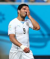 Luis Suarez of Uruguay shows a look of dejection