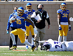 BROOKINGS, SD - APRIL 24: South Dakota State Jackrabbits running back Pierre Strong Jr. #20 scampers down the sideline past Holy Cross Crusaders defensive back Joe Lang #23 at Dana J Dykhouse Stadium on April 24, 2021 in Brookings, South Dakota. (Photo by Dave Eggen/Inertia)