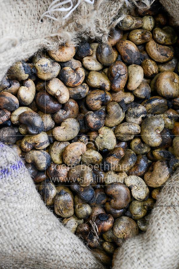INDIA, Karnataka, Moodbidri, cashew processing factory, imported nuts from africa are processed for export , raw cashews with shell from Ghana / INDIEN, Fabrik fuer Verarbeitung von aus Afrika importierten Kaschunuessen, Kaschunuesse mit Schale