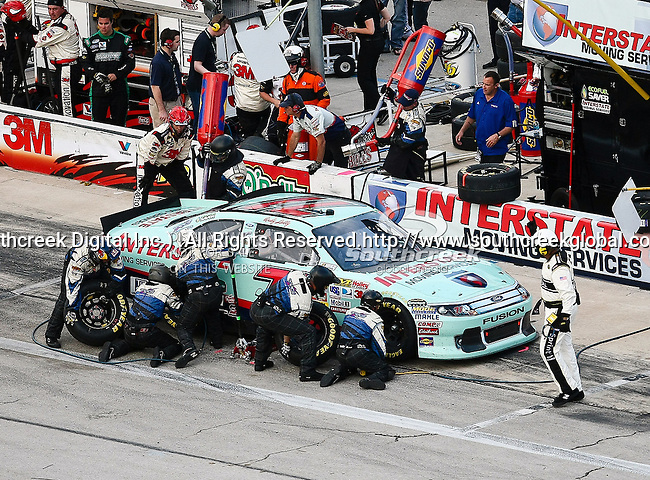 Andy Lally, driver of the (71) Interstate Moving Services Ford, makes a pit stop during the Samsung Mobile 500 Sprint Cup race at Texas Motor Speedway in Fort Worth,Texas.
