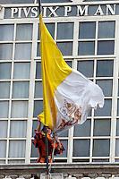Una Guardia Svizzera sistema una bandiera Vaticana nel cortile di San Damaso, Vaticano, 27 marzo 2014.<br /> A Swiss Guard adjusts a Vatican flag at the St. Damaso courtyard, Vatican, 27 March 2014.<br /> UPDATE IMAGES PRESS/Riccardo De Luca<br /> <br /> STRICTLY ONLY FOR EDITORIAL USE