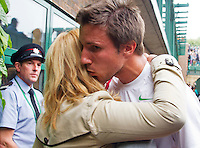 27-06-13, England, London,  AELTC, Wimbledon, Tennis, Wimbledon 2013, Day four, Igor Sijsling (NED) is kissed by his mother after defeating Milos Raonic<br /> <br /> <br /> <br /> Photo: Henk Koster
