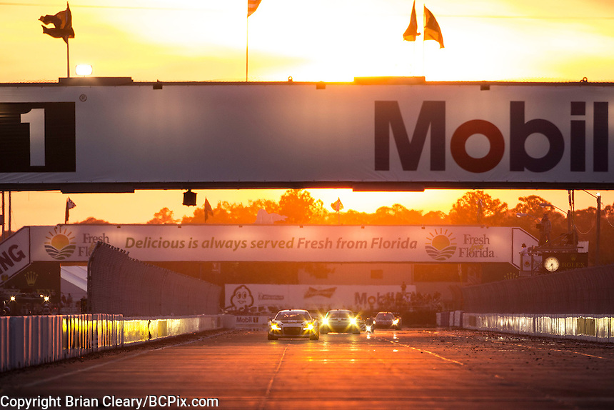 Sunset action, 12 Hours of Sebring, Sebring International Raceway, Sebring, FL, March 2015.  (Photo by Brian Cleary/ www.bcpix.com )