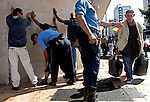 Caracas' Police Officers search people in dowtown Caracas, Venezuela, on Thursday, Jun. 22, 2006. (ALTERPHOTOS/Alvaro Hernandez)