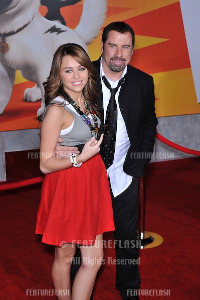 """Miley Cyrus & John Travolta at the world premiere of their new movie """"Bolt"""" at the El Capitan Theatre, Hollywood..November 17, 2008  Los Angeles, CA.Picture: Paul Smith / Featureflash"""