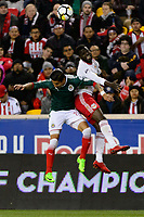 Harrison, NJ - Tuesday April 10, 2018: Carlos Cisneros, Kemar Lawrence during leg two of a  CONCACAF Champions League semi-final match between the New York Red Bulls and C. D. Guadalajara at Red Bull Arena. C. D. Guadalajara defeated the New York Red Bulls 0-0 (1-0 on aggregate).