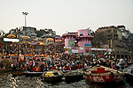 Crowds on the ghats at the Ganges River in Varanasi, Uttar Pradesh, India.