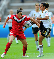 Celia Okoyino da Mbabi (r) of Germany and Rhian Wilkinson of Canada during the FIFA Women's World Cup at the FIFA Stadium in Berlin, Germany on June 26th, 2011.