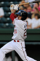 Left fielder Carlos Asuaje (20) of the Greenville Drive in a game against the Augusta GreenJackets on Friday, May 23, 2014, at Fluor Field at the West End in Greenville, South Carolina. (Tom Priddy/Four Seam Images)