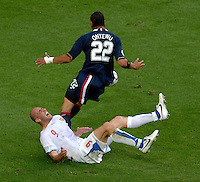 Czech Republic forward Jan Koller goes down with a pulled hamstring after a tackle by U.S. defender Oguchi Onyewu. The Czech Republic defeated the USA 3-0 in their FIFA World Cup Group E opening match at FIFA World Cup Stadium, Gelsenkirchen, Germany, on Monday, June 12, 2006..