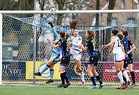 a fight for the ball pictured with goalkeeper Elke Geeraert (25 Brugge) and OHL's Amber Tysiak during a female soccer game between Club Brugge Dames YLA and Oud Heverlee Leuven on the 8 th matchday of the 2020 - 2021 season of Belgian Scooore Womens Super League , saturday 21 th November 2020  in Knokke , Belgium . PHOTO SPORTPIX.BE | SPP | DAVID CATRY