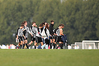 Players of Railway Tavern FC leave the pitch and walk to the dressing rooms after an East London Sunday League match at Hackney Marshes - 11/10/09 - MANDATORY CREDIT: Gavin Ellis/TGSPHOTO - Self billing applies where appropriate - Tel: 0845 094 6026