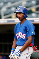 Travis Demeritte #22 of the AZL Rangers during a game against the AZL Royals at Surprise Stadium on July 15, 2013 in Surprise, Arizona. AZL Rangers defeated the AZL Royals, 3-2. (Larry Goren/Four Seam Images)