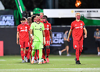 LAKE BUENA VISTA, FL - JULY 26: Michael Bradley of Toronto FC, Quentin Westberg of Toronto FC and teammates enter the field during a game between New York City FC and Toronto FC at ESPN Wide World of Sports on July 26, 2020 in Lake Buena Vista, Florida.