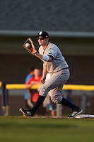 Staten Island Yankees first baseman Connor Spencer (56) catches a throw for the force out during a game against the Batavia Muckdogs on August 8, 2014 at Dwyer Stadium in Batavia, New York.  Staten Island defeated Batavia 4-2.  (Mike Janes/Four Seam Images)