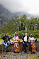 """Switzerland. Canton Valais. St-Maurice. Africa Saints Pilgrimage (Pèlerinage aux Saints d'Afrique). Two caucasian men and two african women belonging to a choir wear loin clothes   with drawings of """"Our Lady of Fátima """" , a title for the Virgin Mary due to her reputed apparitions to three shepherd children at Fátima, Portugal in 1917. The title of Our Lady of the Rosary is also sometimes used to refer to the same apparition. According to religious tradition, Mary was an Israelite Jewish woman and the mother of Jesus. Among her many other names and titles are the Virgin Mary or Blessed Virgin Mary, Mother of God, and Saint Mary in Western churches, Theotokos in Orthodox Christianity, and Maryam, mother of Isa in Islam. The first part of the pilgrimage takes place in Véroliez which is a part of the town of St-Maurice. 2.06.13 © 2013 Didier Ruef"""
