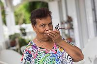 France, île de la Réunion, Bras Panon , Ferme Auberge d'Eva Annibal, Éva  Annibal et ses gousses de vanille //  France, Reunion island (French overseas department), Bras Panon, Eva Annibal framhouse inn,  Éva Hannibal and vanilla pods