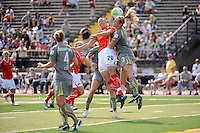 Abby Wambach (20) of the Washington Freedom and Allison Falk (3) of the Philadelphia Independence go up for a header during the first round of the 2010 Women's Professional Soccer (WPS) playoffs presented by MedImmune at John A. Farrell Stadium in West Chester, PA, on September 19, 2010.