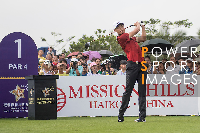 Li Haotong tees off the 1st hole during the World Celebrity Pro-Am 2016 Mission Hills China Golf Tournament on 23 October 2016, in Haikou, China. Photo by Weixiang Lim / Power Sport Images