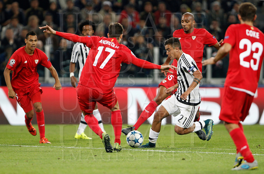 Calcio, Champions League: Gruppo D - Juventus vs Siviglia. Torino, Juventus Stadium, 30 settembre 2015. <br /> Juventus' Paulo Dybala, second from right, is challenged by Sevilla's Marco Andreolli during the Group D Champions League football match between Juventus and Sevilla at Turin's Juventus Stadium, 30 September 2015. <br /> UPDATE IMAGES PRESS/Isabella Bonotto