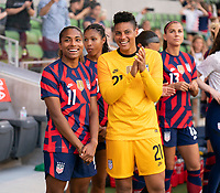 AUSTIN, TX - JUNE 16: Catarina Macario #11 and Adrianna Franch #21 of the USWNT talk before a game between Nigeria and USWNT at Q2 Stadium on June 16, 2021 in Austin, Texas.