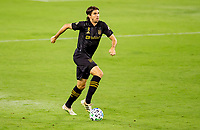 LOS ANGELES, CA - SEPTEMBER 23: Dejan Jakovic #5 of LAFC dribbles the ball during a game between Vancouver Whitecaps and Los Angeles FC at Banc of California Stadium on September 23, 2020 in Los Angeles, California.