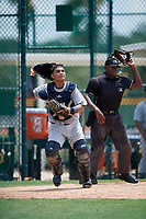 GCL Tigers West catcher Eliezer Alfonzo (35) follows the play in front of home plate umpire Tre Jester during a game against the GCL Pirates on August 13, 2018 at Pirate City Complex in Bradenton, Florida.  GCL Tigers West defeated GCL Pirates 5-1.  (Mike Janes/Four Seam Images)