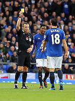 Liverpool, UK. Saturday 01 November 2014<br /> Pictured: Gareth Barry of Everton (R) is shown a yellow card by referee Kevin Friend for his foul against Gylfi Sigurdsson.<br /> Re: Premier League Everton v Swansea City FC at Goodison Park, Liverpool, Merseyside, UK.