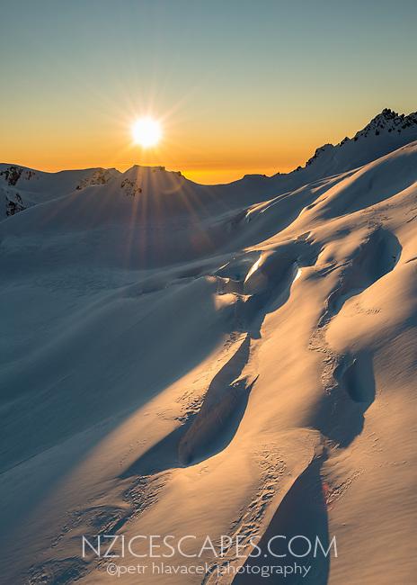 Sunset on slopes of Baird Range in upper parts of Franz Josef Glacier, Westland Tai Poutini National Park, West Coast, UNESCO World Heritage Area, New Zealand, NZ