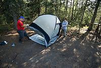 Nick Lynch and Kirsten Olsen set up their tent at a camp along the Kenai River.