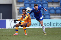 Tom Eastman of Colchester United and Jamie Reid of Mansfield Town during Colchester United vs Mansfield Town, Sky Bet EFL League 2 Football at the JobServe Community Stadium on 14th February 2021