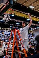 16 March 2019: University of Vermont Catamount Center Jake Lorenzo, a Freshman from Englishtown, NJ, cuts himself a piece of net after a victory over the UMBC Retrievers in the America East Championship Game at Patrick Gymnasium in Burlington, Vermont. The Catamounts defeated the Retrievers 66-49, avenging their loss against the same team in last years' Championship Game. Mandatory Credit: Ed Wolfstein Photo *** RAW (NEF) Image File Available ***