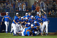Alex Faedo (21) of the Florida Gators is mobbed by his teammates after getting the final out against the Wake Forest Demon Deacons in Game Three of the Gainesville Super Regional of the 2017 College World Series at Alfred McKethan Stadium at Perry Field on June 12, 2017 in Gainesville, Florida. The Gators defeated the Demon Deacons 3-0 to advance to the College World Series in Omaha, Nebraska. (Brian Westerholt/Four Seam Images)