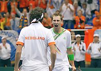 05-03-11, Tennis, Oekraine, Kharkov, Daviscup, Oekraine - Netherlands, Thiemo de Bakker/Robin Haase   winnen de derde set