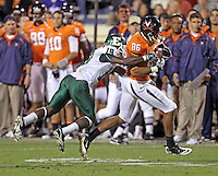Oct 23, 2010; Charlottesville, VA, USA;  /v86 makes a catch in front of Eastern Michigan Eagles cornerback Arrington Hicks (19) during the game at Scott Stadium.  Virginia won 48-21. Mandatory Credit: Andrew Shurtleff