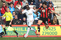 Modou Barrow of Swansea City of Swansea City  and Charlie Daniels of Bournemouth during the Barclays Premier League match between AFC Bournemouth and Swansea City played at The Vitality Stadium, Bournemouth on March 11th 2016