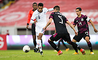 GUADALAJARA, MEXICO - MARCH 24: Jesus Ferreira #9 of the United States passes off the ball during a game between Mexico and USMNT U-23 at Estadio Jalisco on March 24, 2021 in Guadalajara, Mexico.