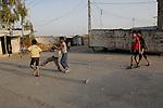 DOMIZ, IRAQ: Boys play football in the Domiz refugee camp...Over 7,000 Syrian Kurds have fled the violence in Syria and are living in the Domiz refugee camp in the semi-autonomous region of Iraqi Kurdistan...Photo by Ari Jalal/Metrography