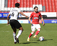24th April 2021; The Valley, London, England; English Football League One Football, Charlton Athletic versus Peterborough United; Nathan Thompson (Peterborough) takes on Jake Forster-Caskey (Charlton)