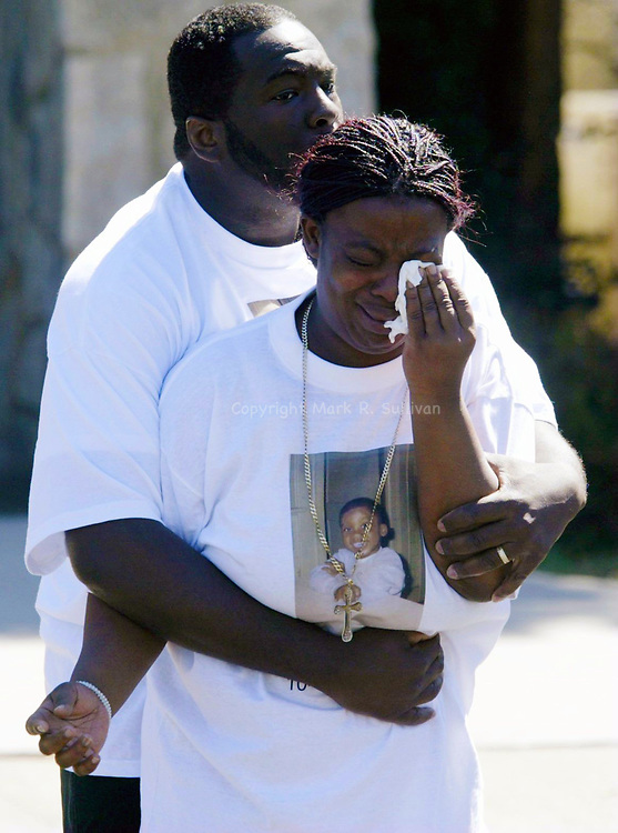(FUNERAL)--29358-funeral0331a-On Mon Mar 31,2003--METRO-Willie Faulk (rear) tries to console his sister Dorothy Faulk as both emerge from the funeral services at the First Presbyterian Church of Avenel for  3 yr old Amiri LaQuan Beeks of Woodbridge. The 3 yr old was murdered last week by a 10 year old boy. (MARK R. SULLIVAN/HNT CHIEF PHOTOGRAPHER)