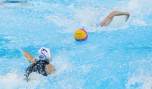 30 JUL 2012 - LONDON, GBR - Competitors race for the ball at the restart of the women's London 2012 Olympic Games preliminary round water polo match between the USA and Hungary at the Olympic Park, Stratford, London, Great Britain (PHOTO (C) 2012 NIGEL FARROW)