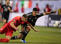 CHICAGO, IL - JULY 7: Matt Miazga #19 and Raul Jimenez #9 contest the ball during a game between Mexico and USMNT at Soldiers Field on July 7, 2019 in Chicago, Illinois.