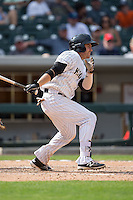 J.B. Shuck (30) of the Charlotte Knights follows through on his swing against the Gwinnett Braves at BB&T BallPark on May 22, 2016 in Charlotte, North Carolina.  The Knights defeated the Braves 9-8 in 11 innings.  (Brian Westerholt/Four Seam Images)