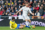 Vicente Gomez of UD Las Palmas competes for the ball with Cristiano Ronaldo of Real Madrid during the match of Spanish La Liga between Real Madrid and UD Las Palmas at  Santiago Bernabeu Stadium in Madrid, Spain. March 01, 2017. (ALTERPHOTOS / Rodrigo Jimenez)