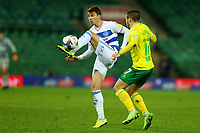 29th December 2020; Carrow Road, Norwich, Norfolk, England, English Football League Championship Football, Norwich versus Queens Park Rangers; Tom Carroll of Queens Park Rangers is under pressure from Emi Buendia of Norwich City
