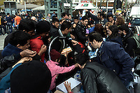 Pictured: Food and milk is handed out to migrants Friday 26 February 2016<br /> Re: Hundreds of refugees have temporarily camped at Victoria Square in central Athens, Greece.