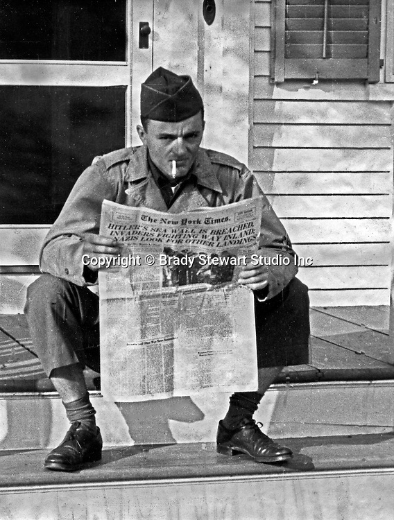 Martha's Vineyard MA:  Brady and Marjorie Zapp Stewart were married in Valley Cottage New York on June 4th, 1944. While on his honeymoon at Martha's Vineyard, he was recalled to base due to the D-Day invasion. Marjorie Stewart snapped this photograph of Brady Stewart Jr reading the news of the invasion on the morning of June 7th, 1944.